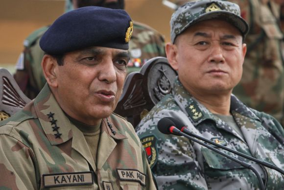 Pakistani Army Chief General Ashfaq Kayani speaks beside Chinese General Hou Shusen after a joint military exercises in Pakistan
