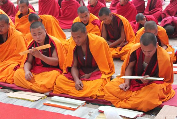 Buddhist monks reading scriptures in Bodh Gaya