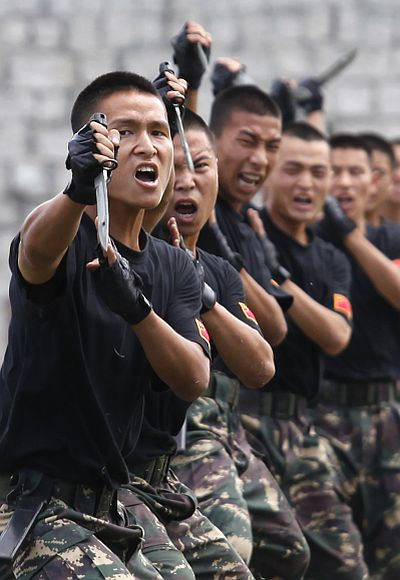 Chinese People's Liberation Army soldiers demonstrate martial arts during a military exercise.