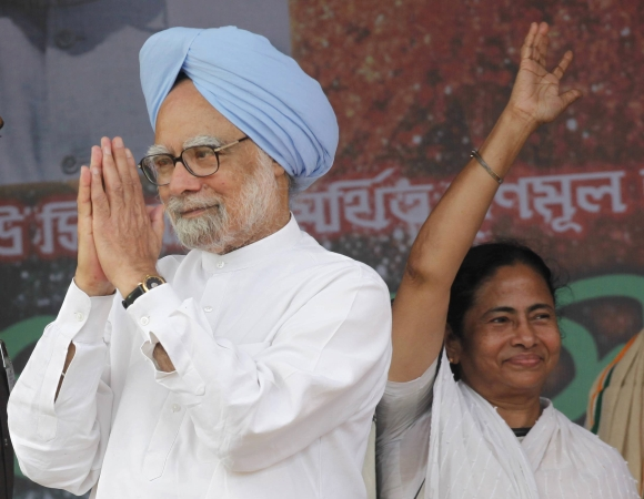Trinamool Congress Chief Mamata Banerjee along with Prime Minister Manmohan Singh before she walked out of the coalition