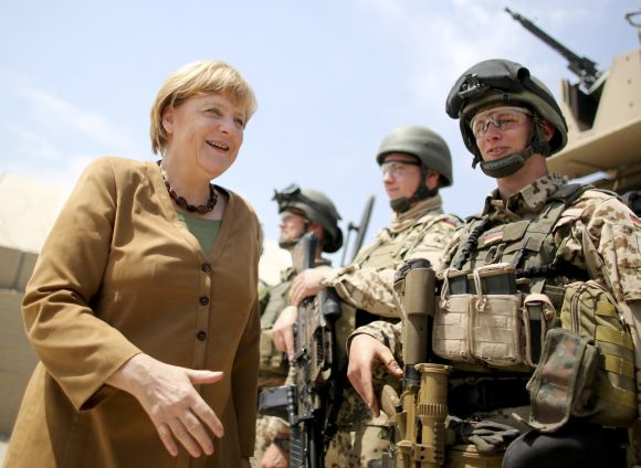 Chancellor Angela Merkel meets with soldiers as she visits a German army base in Afghanistan