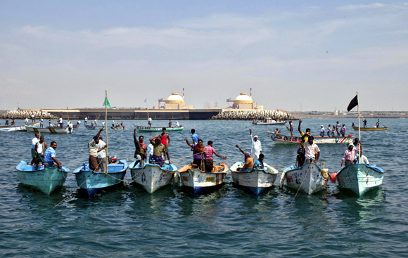 Demonstrators stand in their boats in the Bay of Bengal during a protest near the Kudankulam nuclear power project