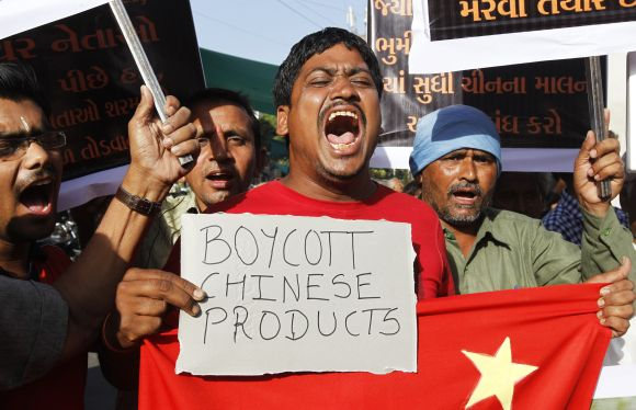 Traders shout slogans during a protest against China in Ahmedabad