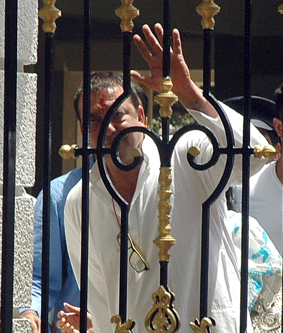 Actor Sanjay Dutt waves to the media outside his Bandra residence before he surrendered on May 16