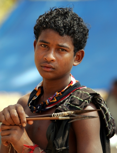 An tribal teenager holds a bow and arrows in Dharbaguda, in the central state of Chhattisgarh