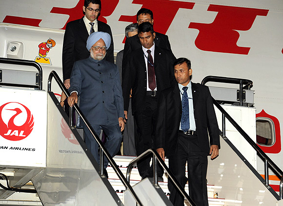 Prime Minister Manmohan Singh steps out of Air India One on his arrival at Tokyo's Haneda International Airport.