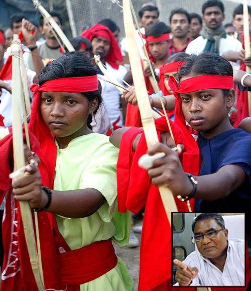 Female Naxalite fighters pose with the bow and arrow at a rally in Kolkata. Inset: Mahendra Karma