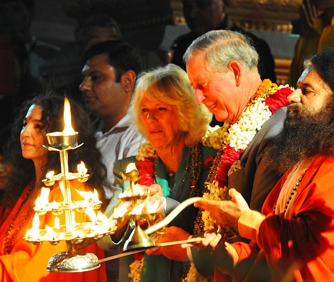 Prince Charles and his wife Camilla Parker Bowles attend Ganga arti in Rishikesh on Wednesday