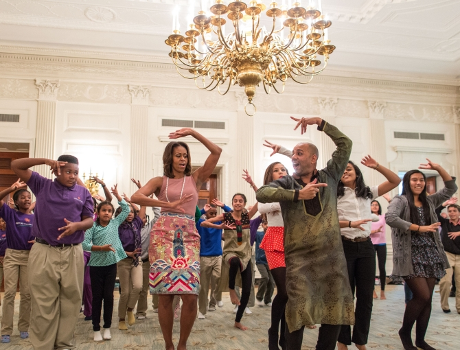 First Lady Michelle Obama joins students for a Bollywood dance in the State Dining Room of the White House along with choreographer Nakul Mahajan