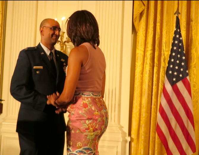 Lt Col Ravi Chaudhary with Michelle Obama at the White House