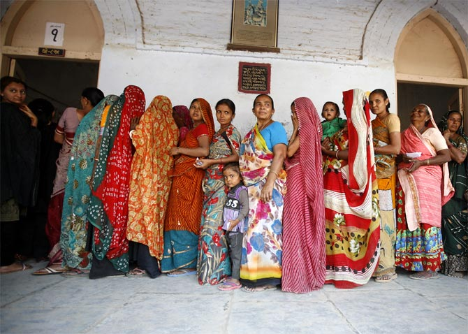 Women wait to cast their ballots outside a polling booth in Viramgam, Gujarat, December 2012.