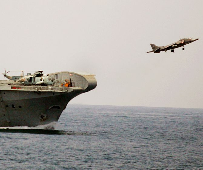 A fighter Sea Harrier takes off from INS Virat near the coast