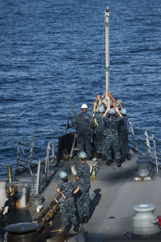 Sailors aboard the Arleigh Burke-class guided-missile destroyer USS McCampbell (DDG 85) work together to raise the jack-staff as the ship arrives in Chennai for a port visit.