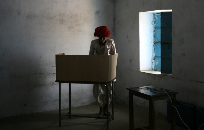A man casts his vote at a polling centre in Rajasthan