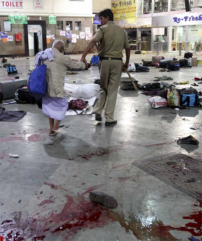 A policeman and an elderly man at the CST station in Mumbai, one of the sites of the 26/11 attacks.