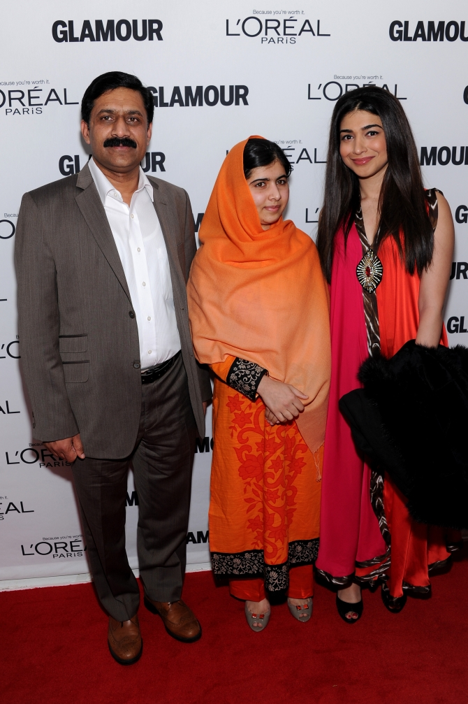 Malala with her father Ziauddin Yousafzai arrive for the award function in New York