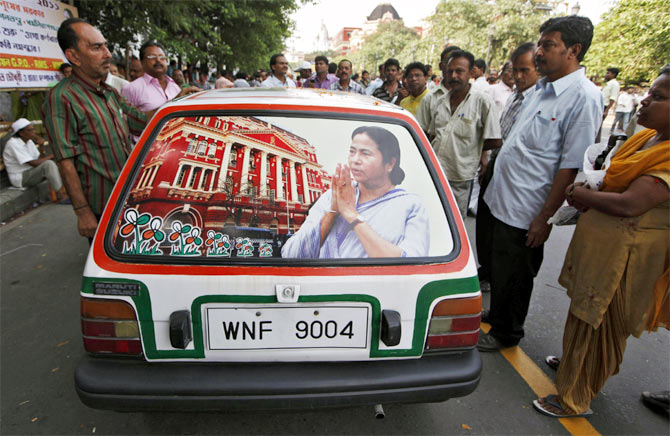 A car decorated with an image of Mamata Banerjee after she took the oath as chief minister.