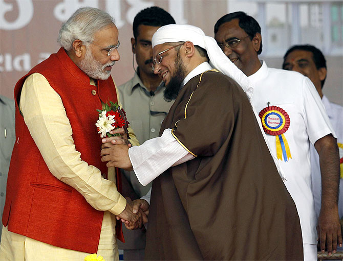 BJP prime ministerial candidate Narendra Modi receives flowers from a Muslim cleric after the inauguration of a hospital run by a Muslim trust in Balasinore, near Ahmedabad.