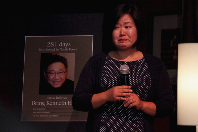 Terri Chung, sister of Kenneth Bae, cries during a speech at a vigil for Kenneth Bae in Seattle, Washington