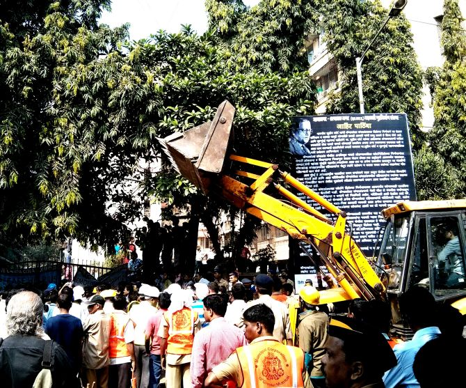 A Brihanmumbai Municipal Corporation bulldozer waits outside the Campa Cola housing society.