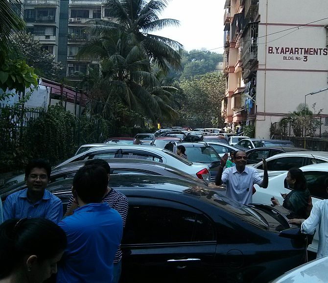 Residents parked their cars near the gates to block the BMC staff from entering the compound