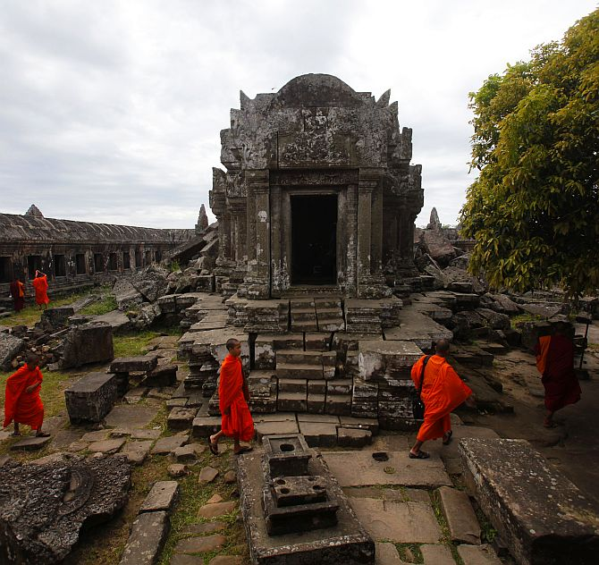 Buddhist monks visit the 900-year-old Preah Vihear temple on the border between Thailand and Cambodia
