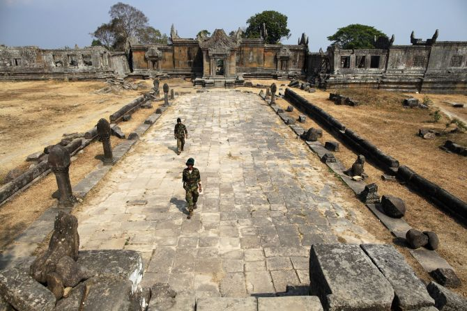 Cambodian soldiers walk at the 11th-century Preah Vihear temple on the border between Thailand and Cambodia.