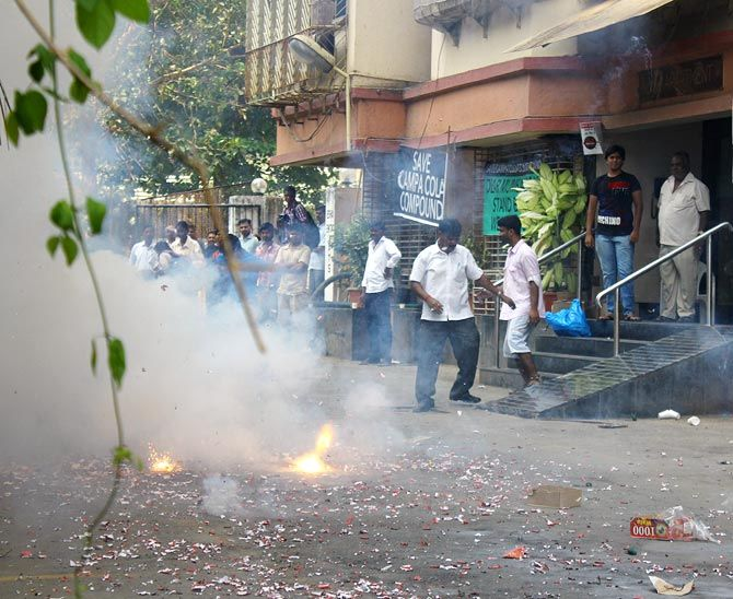 Residents burning crackers to celebrate the SC order