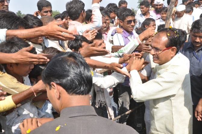 Shivraj Singh Chouhan greets supporters during a function at Nepanagar
