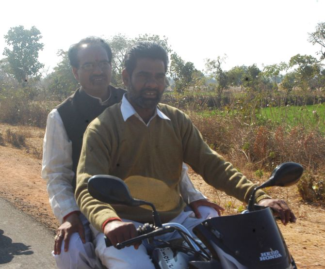 Shivraj Singh Chouhan travels on a motorbike to reach the venue of his rally in MP