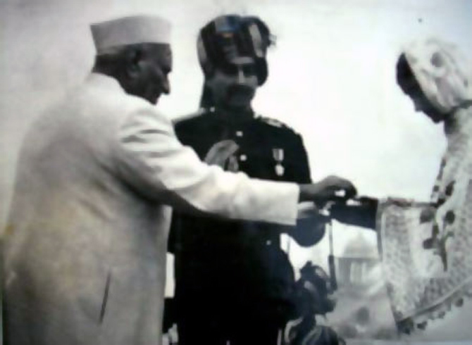 A hero's widow is awarded the Param Vir Chakra by the President of India.
