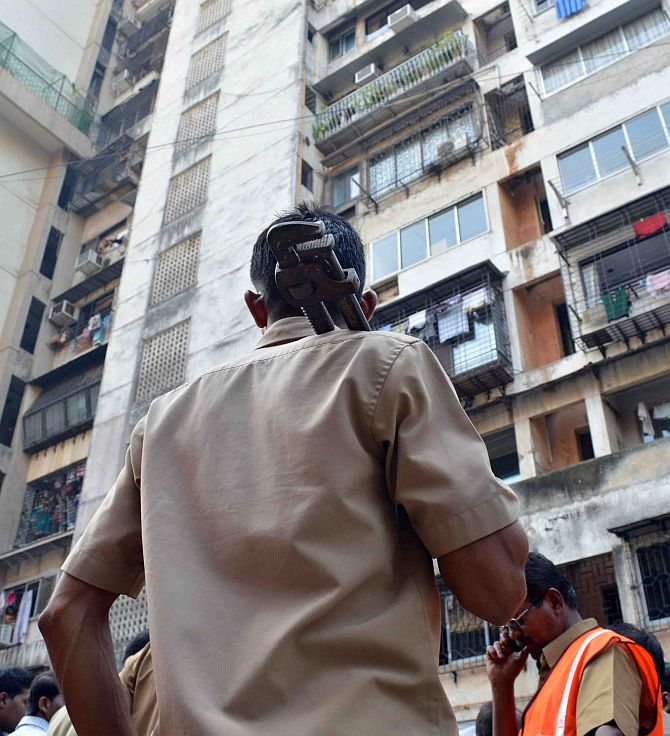 A municipal worker at the Campa Cola building compound in Worli, south-central Mumbai, November 13, 2013.