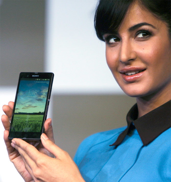 Katrina Kaif displays a smartphone during its launch