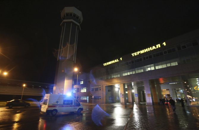An ambulance is seen outside the main building of Kazan airport following the plane crash on Sunday