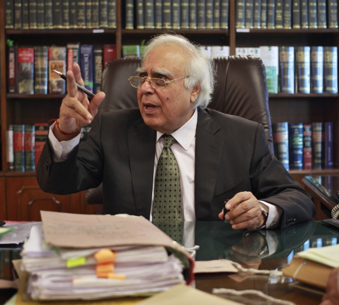 Telecommunications Minister Kapil Sibal gestures after an interview at his office in New Delhi