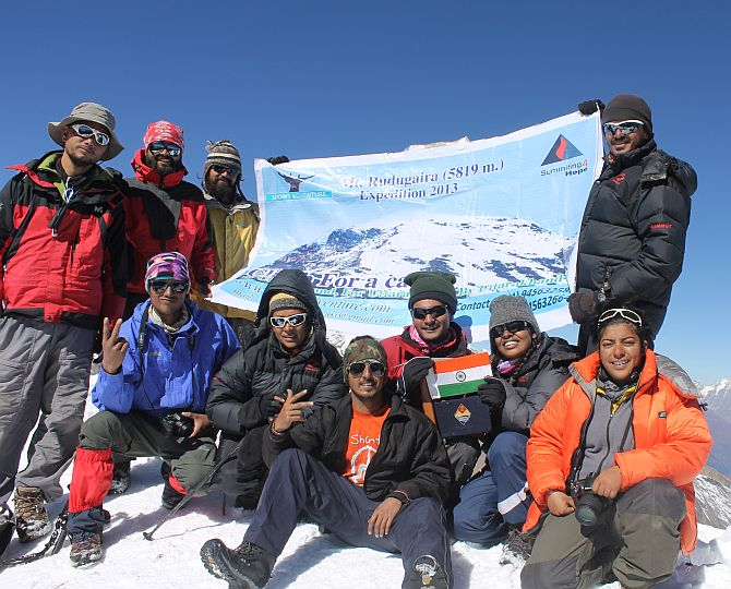 The 12-member Summitng4Hope team atop Mt Rudugaira