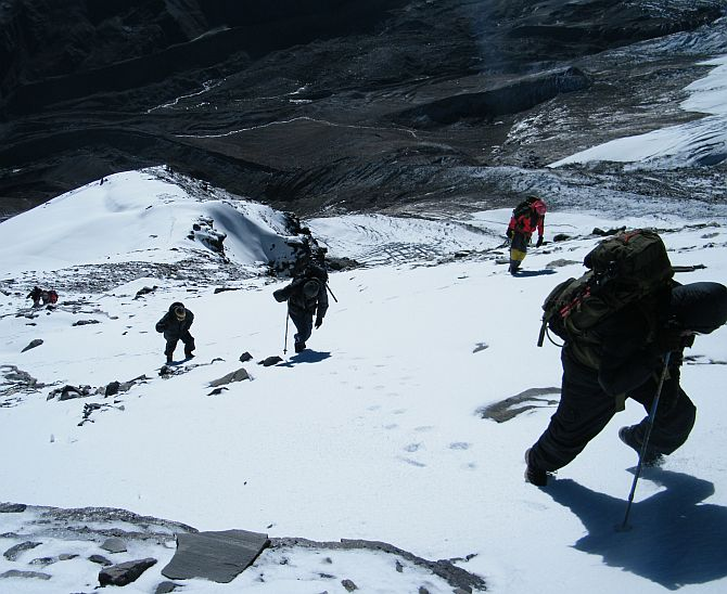 The team on the way to the top of Mt Rudugaira