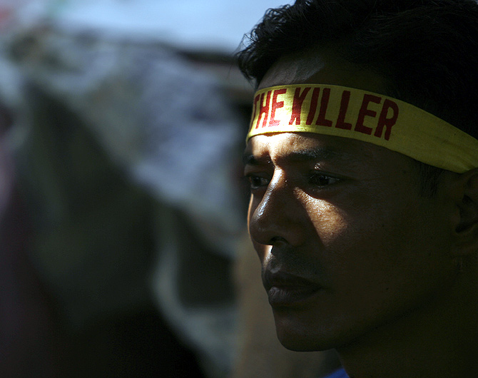 A Tibetan exile watches during a hunger strike against the Chinese government in Delhi