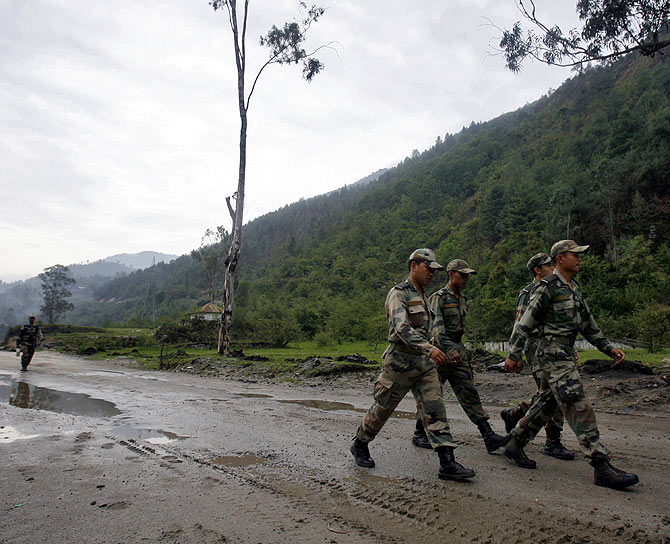 Indian soldiers march near an army base on India's Tezpur-Tawang highway, which runs to the Chinese border, in Arunachal Pradesh