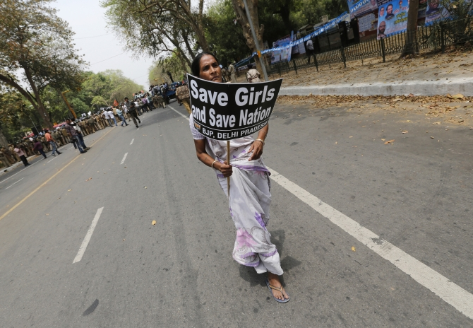 A woman participates in a protest against the Delhi gang rape