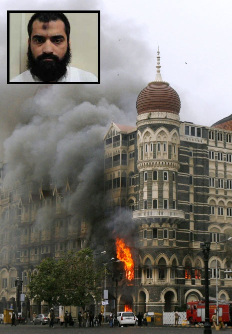 The Taj Mahal hotel is seen engulfed in smoke during a gun battle in Mumbai in this picture taken on November 29, 2008.