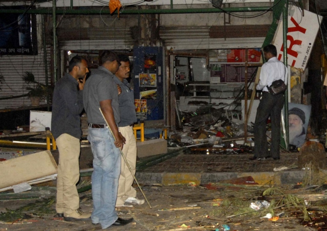 Police gather at the site of a bomb blast at the German Bakery restaurant in Pune in this picture taken on February 13, 2010.