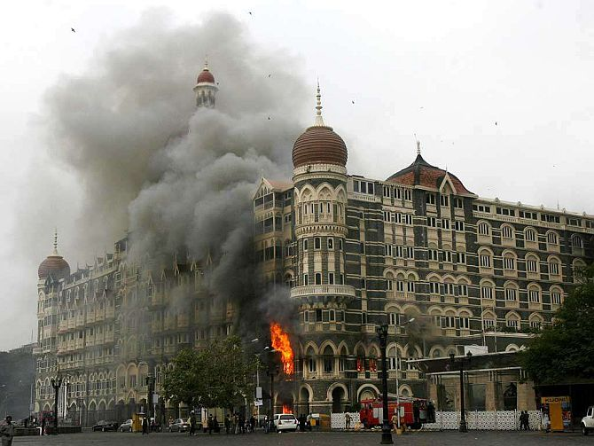 The iconic Taj Hotel burning during the infamous Mumbai terror attack of 2008.