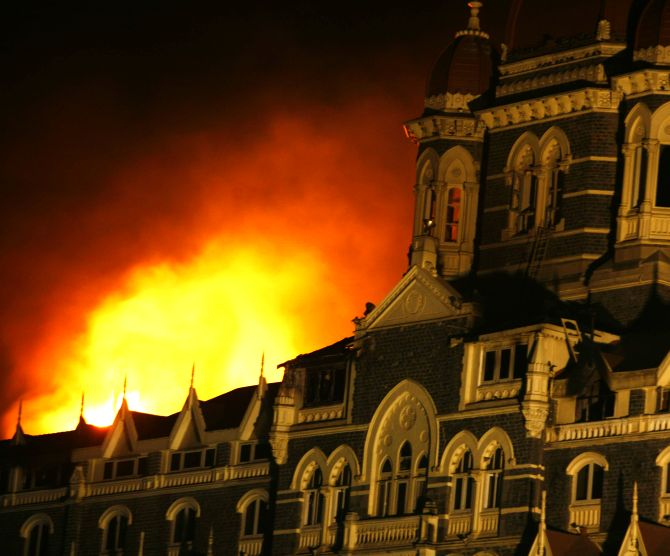 Smoke and fire billows out of the Taj Hotel in Mumbai during the 26/11 terror attacks