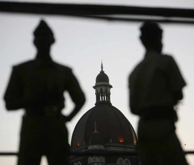 Policemen stand guard outside the Taj Mahal hotel, one of the sites of the 26/11 attacks
