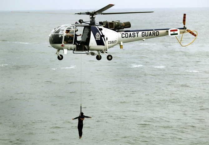 The Coast Guard's Chetak helicopter takes part in a demonstration near the Mumbai coast.