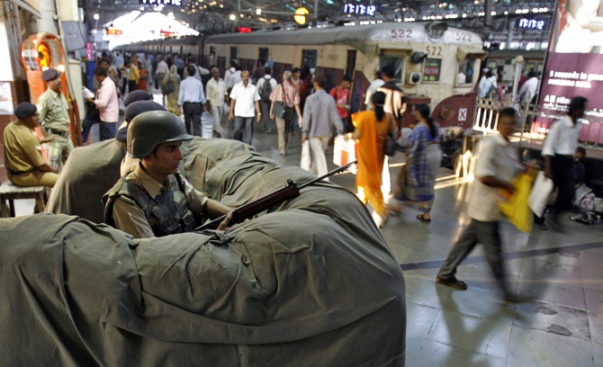 A railway police commando stands guard at the Chhatrapati Shivaji Terminus, one of the sites of the 26/11 attacks in Mumbai.
