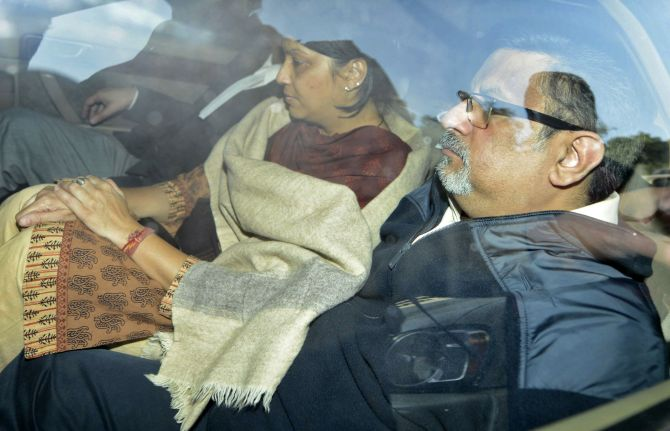 Dentists Rajesh Talwar and wife Nupur are taken to court in Ghaziabad, on the outskirts of New Delhi