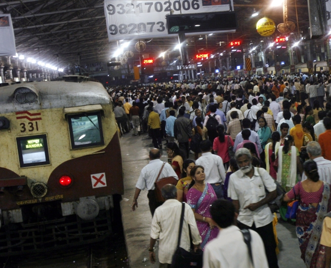 People walk on platforms of the Chhatrapati Shivaji Terminus railway station, which was targetted on 26/11