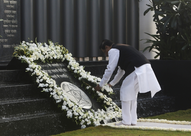 Maharashtra's Chief Minister Prithviraj Chavan places a wreath as he pays tribute at the Gymkhana police memorial marking the November 2008 Mumbai attacks